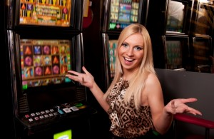 Young woman in Casino on a slot machine